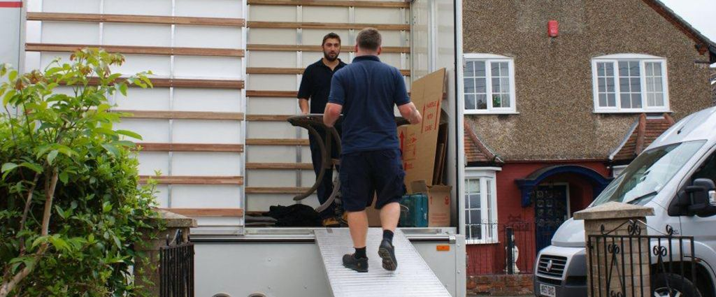 removal men carrying item out of van