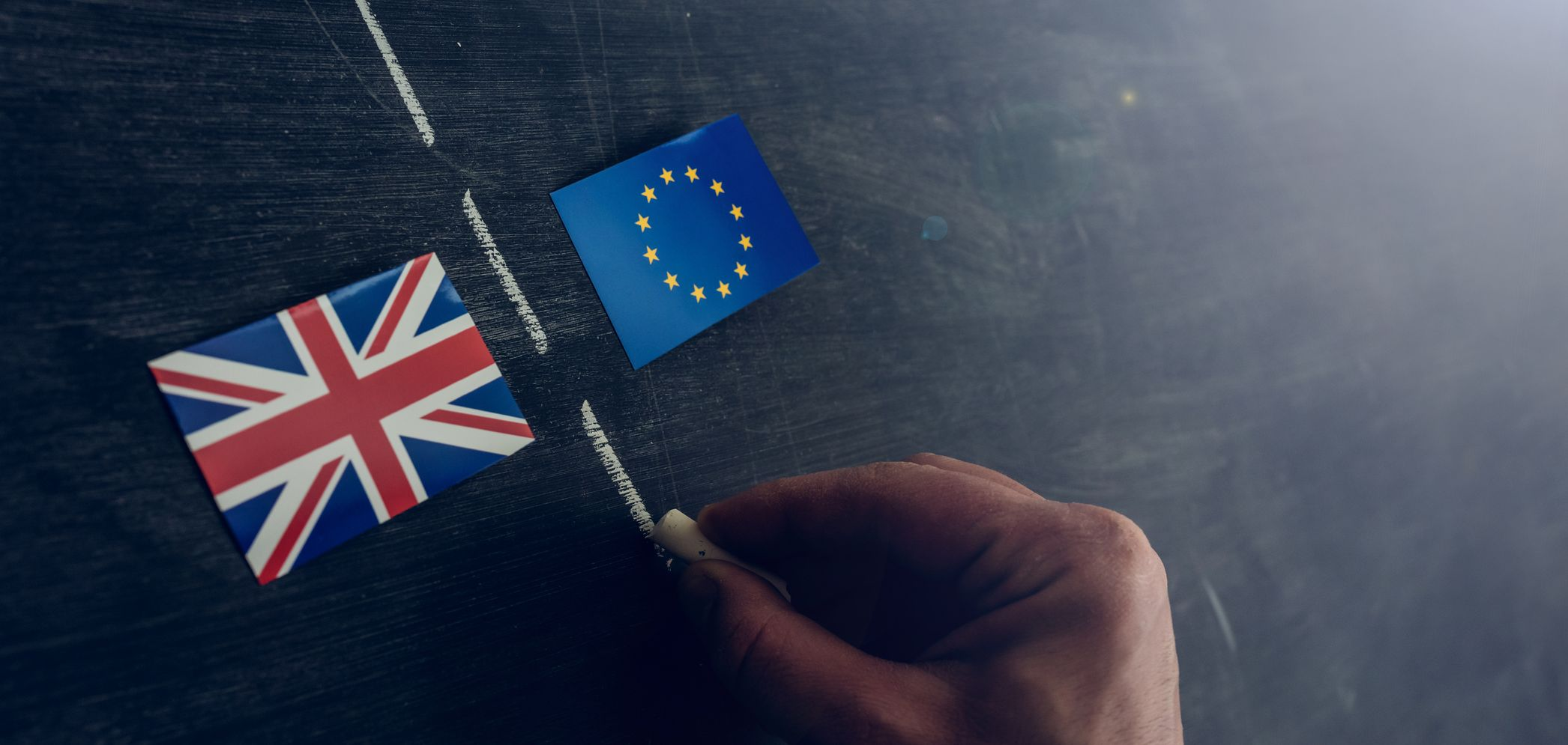 hand drawing lines between uk and eu flag